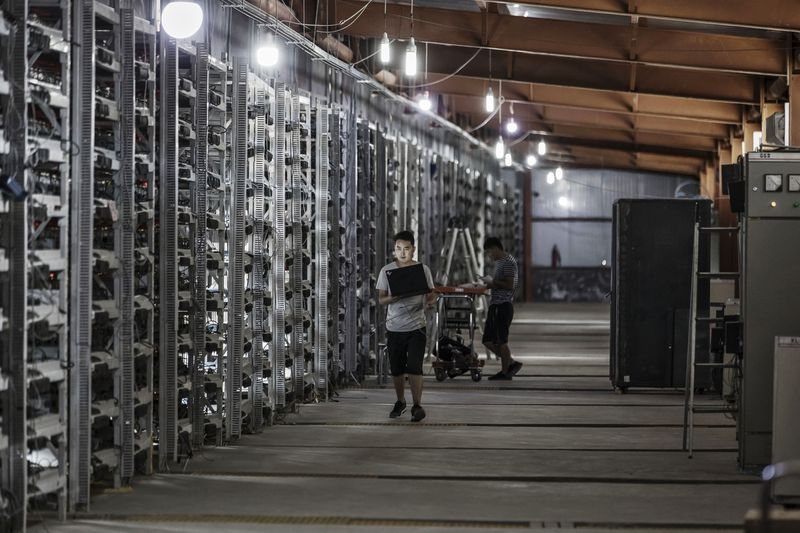 chinese miners in a bitcoin mine
